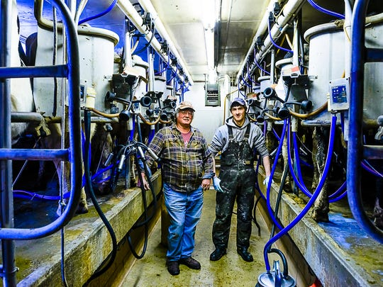 Fogle Farms owner Rick Fogle, left, and Dan Abbott,