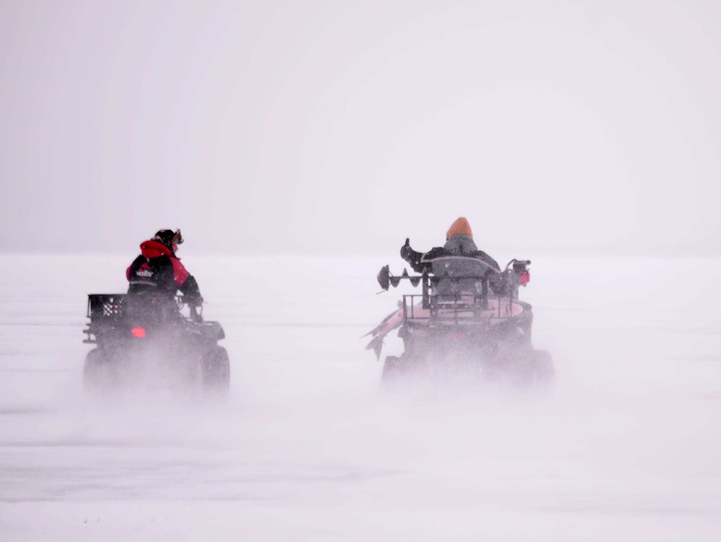 Scott Ash, left, and Brett Trepanier drive their catches