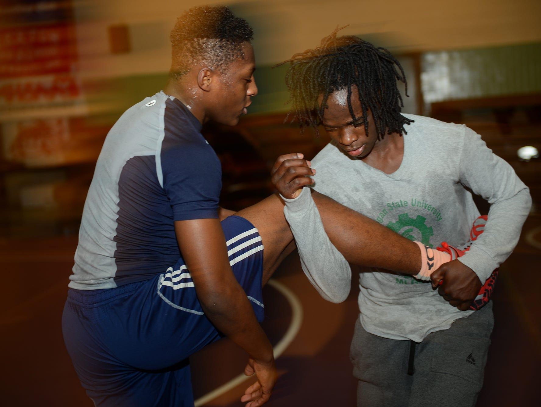 Wrestlers Kedrick Tegue, left, and Ibrahim Mkumbukwa run drills on Tuesday, Feb. 7, 2017 at Sexton High School.
