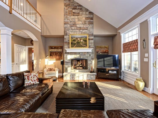 This home has a two-story family room with a wall of