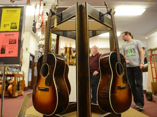 The Farida Old Town series guitars on display on Wednesday, March 1, 2017 at Elderly Instruments in Lansing.
