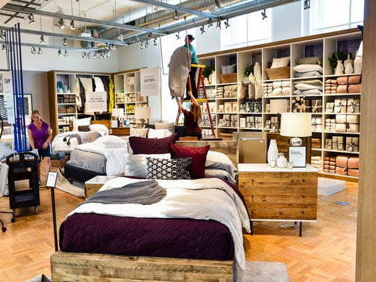 Workers put the finishing touches on a West Elm store