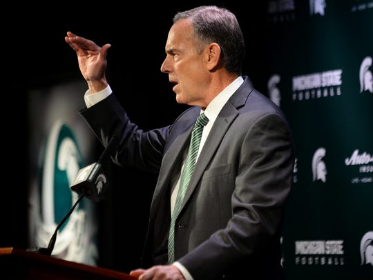 Head coach Mark Dantonio speaks to the media during