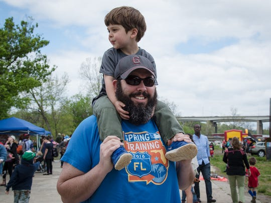 Jeff Whitworth carries Harris on his shoulders while visiting the Earth Day Kids Festival in 2016.