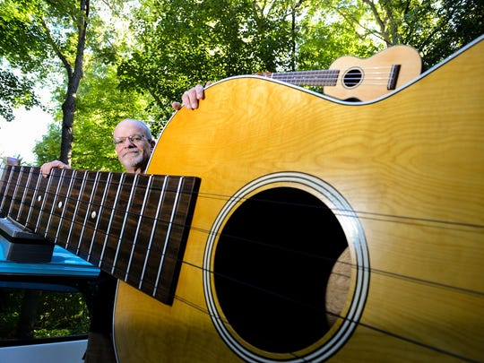 Larry Stump with his ukulele. At 13 feet, 1 inch long,