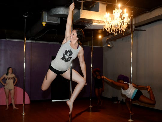 Studio owner Candice Tess demonstrates a move during