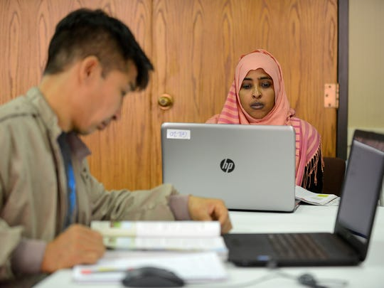 Jamila Khayame works on her exam work during class at the Global Institute of Lansing Monday, May 22, 2017, at First Presbyterian Church in Lansing. The Global Institute of Lansing offers adult refugees and immigrants a chance to earn their high school diplomas.