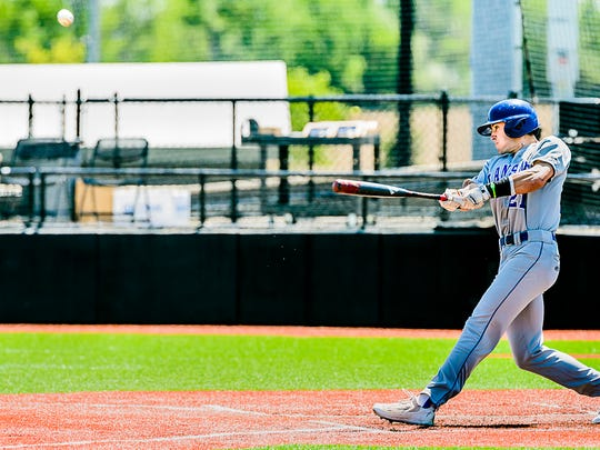 LCC's Jake Crum drives a Sinclair pitch out of the park for a solo home run to give the Stars' an 8-0 lead in the third inning of their NJCAA Region 12 Tournament championship Monday at Davenport University Baseball Stadium in Caledonia, Michigan.
