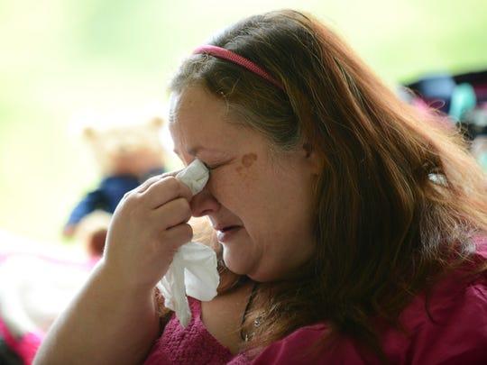 Candice Van Hoogen cries as she talks about her daughter