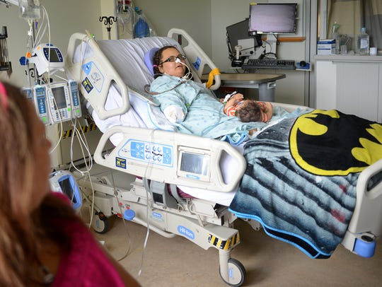 Brittany Van Hoogen sits in her hospital room on Thursday,