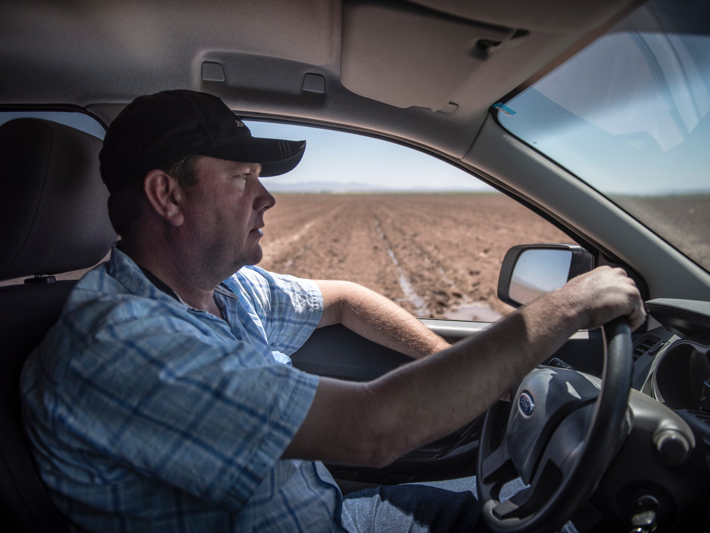 Mexican farmer Pedro Suderman drives his diesel truck June 13, 2017, to monitor the progress on a drip irrigation system he has installed in his chile, onion and watermelon fields in the northern Mexico Mennonite community of El Camello.