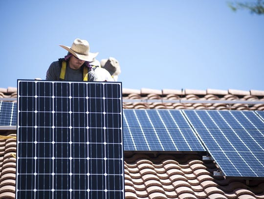 Solar panels are installed on a roof. SRP has about 180 megawatts of solar on its system that customers have installed.