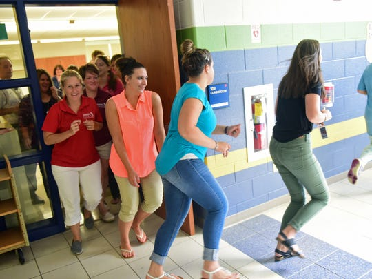 Fayetteville Elementary School faculty members evacuate
