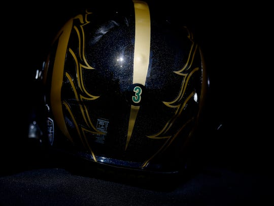 Western Michigan's players are wearing special helmets