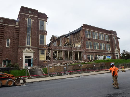 The original front facade of the former Chambersburg High School (1909) had been hidden in the middle of the former Central Junior High School since the gymnasium and auditorium wing was added in 1930. On Wednesday, September 13, 2017 the walls came down, making it once again visible from Third Street.