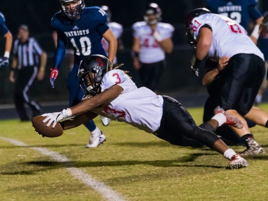 Liberty's Kevon Tabron (3) dives for a 6 yard touchdown run against Powdersville on Friday night.