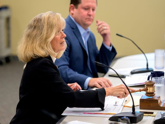 Chairwoman Janet McClelland calls the Michigan Civil Service Commission meeting to order on Wednesday, Sept. 20, 2017, at the Capitol Commons Center in Lansing. Commissioner Jase Bolger is seen in the background.