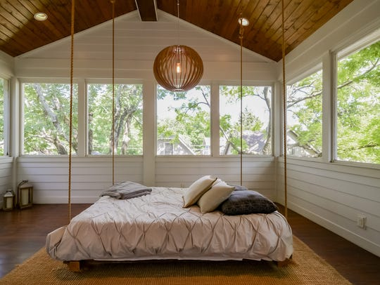 The upstairs sleeping porch is a peaceful retreat off