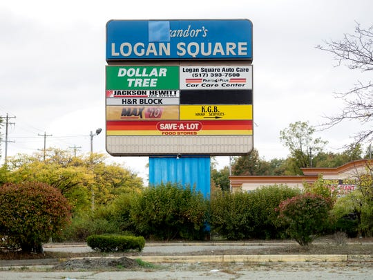 The Logan Square shopping center sign photographed on Thursday, Oct. 12, 2017, in Lansing. The property was bought by a real estate investment group from California in late 2018.
