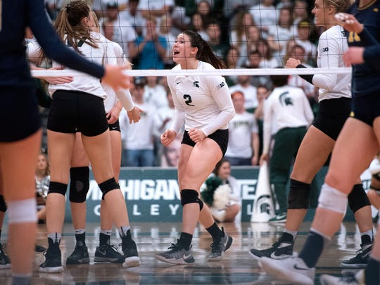Michigan State's Autumn Bailey celebrates a point with teammates during the second game of the Spartans' match against Michigan on Wednesday, Oct. 18, 2017, at the Jenison Field House in East Lansing.