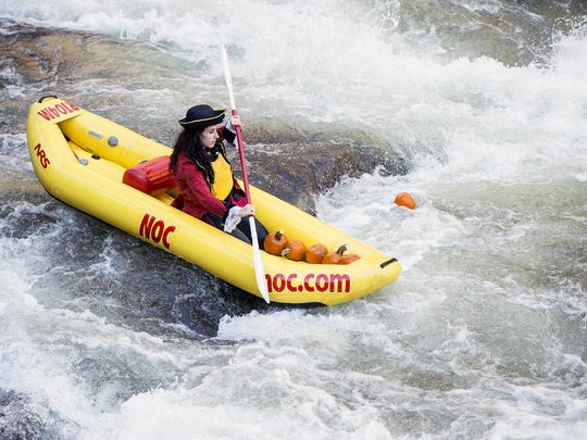 Contestants paddle after pumpkins at the Nantahala Outdoor Center during a past Great Pumpkin Pursuit