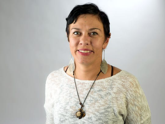 Lisa Lee poses for a portrait. Lee is a psychiatric case manager and off-campus Crossroads coordinator at Alta Vista Mental Health. She is also the founder of Voices of Inspiration, Courage, and Empowerment (VOICE) a writing group for people experiencing homelessness.