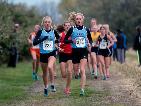 LCC runner Olivia Theis, center, has broken the 17-minute mark in cross-country multiple times this season.