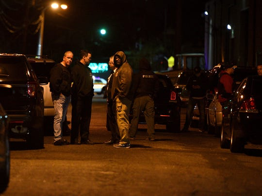 Members of the Paterson, N.J., police department gather Tuesday, Oct. 31, 2017, near the home of Sayfullo Saipov 29. Saipov is accused of plowing a pickup truck down a crowded bike path along the Hudson River in Manhattan on Tuesday, Oct. 31, 2017.