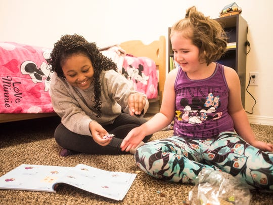 Rahja Steel, 12, and Jaydee Doland, 7, play with legos in Jaydee's room Friday, Nov 10. Their mothers, Jazmyn and Alissa, built their next-door homes through NeighborWorks' Owner Built Homes program and completed their builds in time for the holidays.