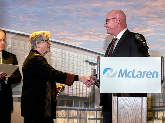 McLaren Greater Lansing President and CEO Tom Mee, right, shakes hands with MSU President Lou Anna K. Simon during a press conference announcing McLaren's plan to build a $450 million hospital adjacent to Michigan State University on Monday, Dec. 4, 2017, at the University Club in East Lansing.