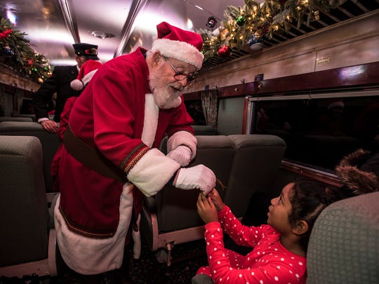 Santa gives a bell to Ava Berroa, 6, of Rutherford at the Polar Express event at the Whippany Train Museum, Dec. 7, 2017. Photo by Warren Westura for the Daily Record.