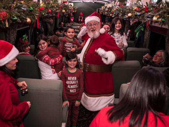 Santa poses for a photo with riders aboard the Polar Express at the Whippany Train Museum. Photo by Warren Westura for the Daily Record.