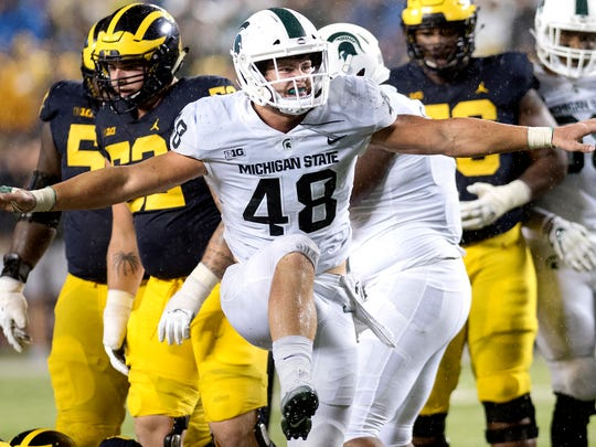Michigan State's Kenny Willekes celebrates a tackle