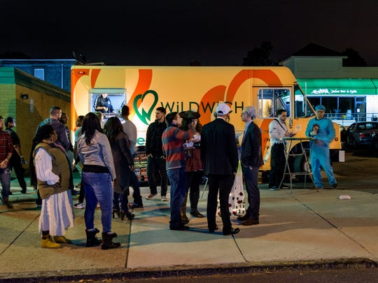 A crowd gathers in the early morning hours after 2015's Halloween Loop near Wilmington's Trolley Square.