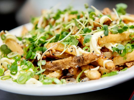 A current specialty, Okonomi fries photographed on
