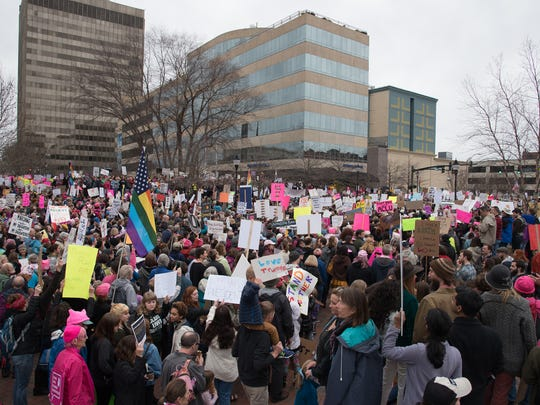 In solidarity with the Women's March on Washington, Asheville community members marched peacefully in 2017 to show the new administration they stand with families and friends for the protection of rights, safety, and health.