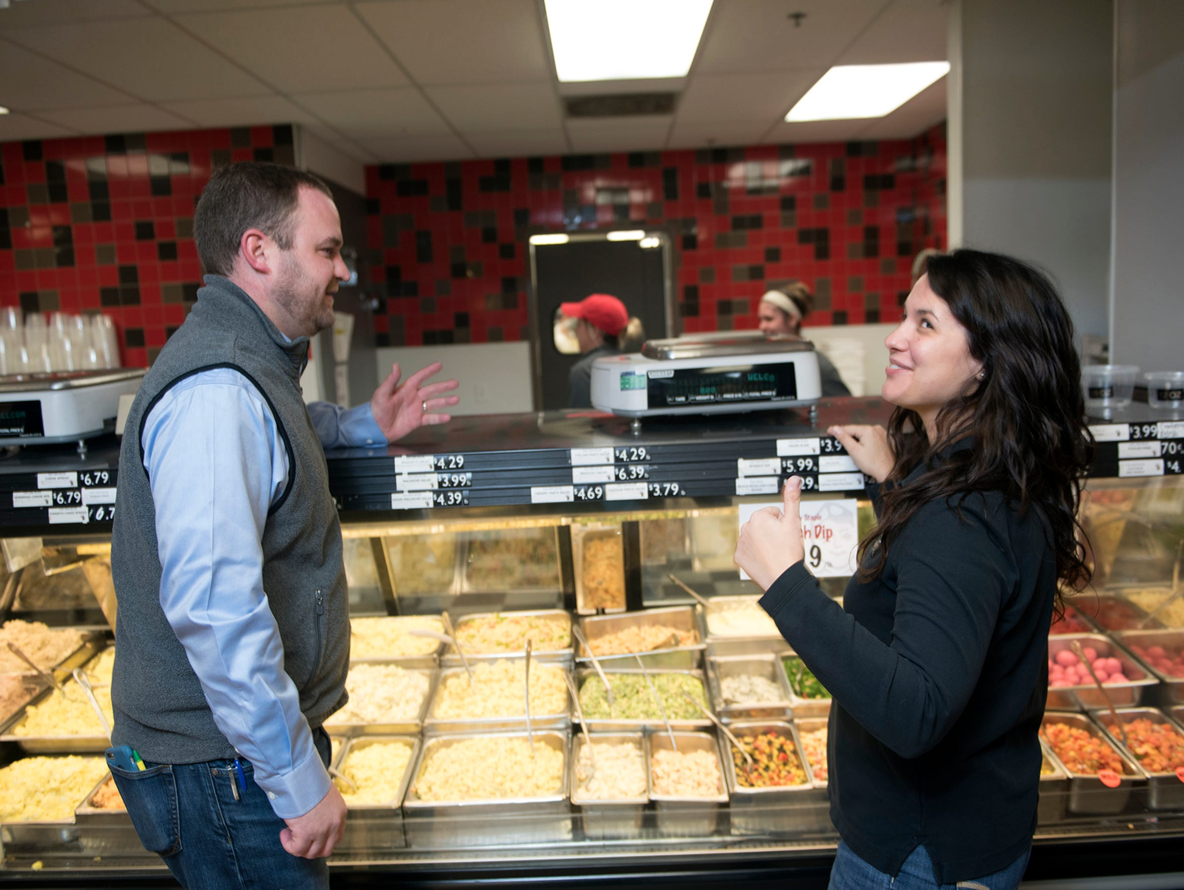 Leo and Anne Schoenhofen, owners The Butcher Shoppe, chat in front of a display of various side dishes at the local grocery, 410 Stouffer Ave., Chambersburg, on Tuesday, Jan. 30.