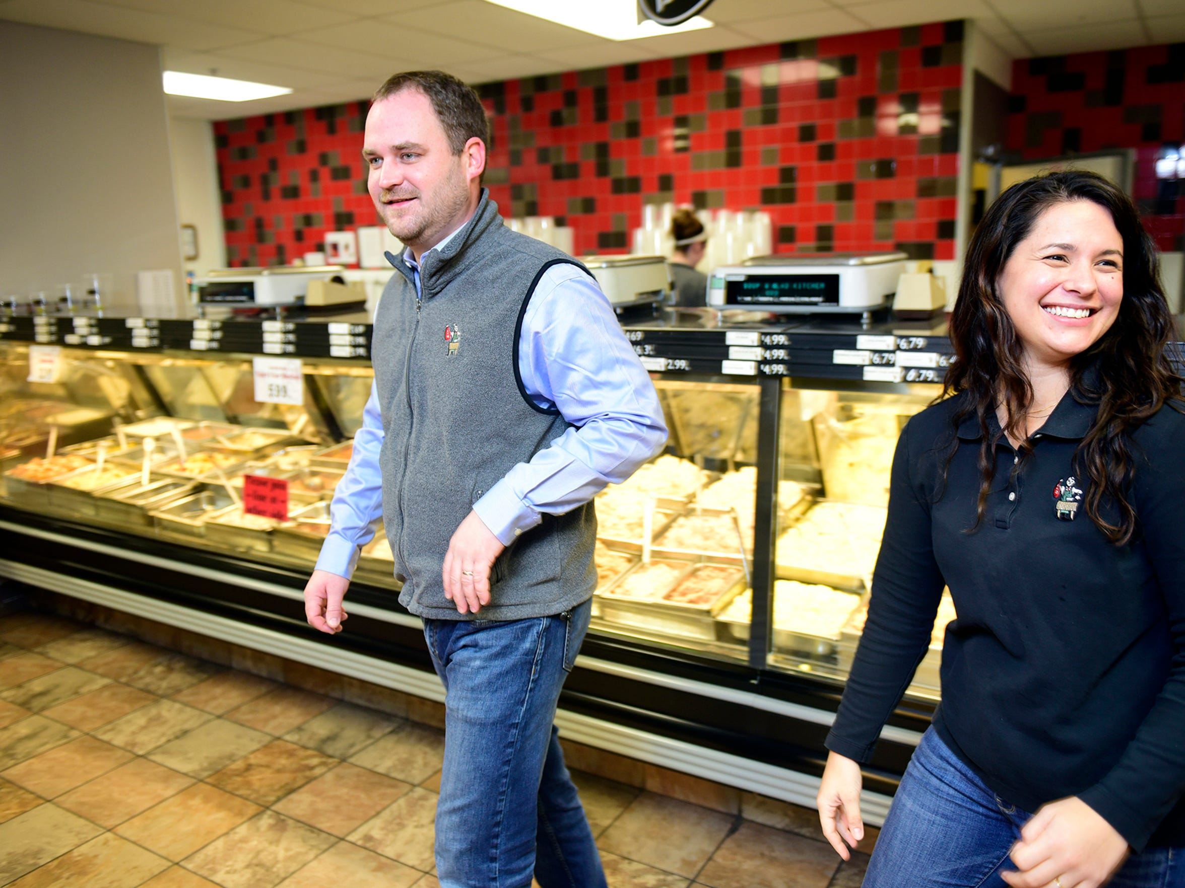 Owners Leo and Anne Schoenhofen walk through The Butcher Shoppe, on Stouffer Avenue in Chambersburg, on Tuesday, Jan. 30. They took over the business from Anne's parents about a year ago. Anne is the granddaughter of founder, Glenn Koons.