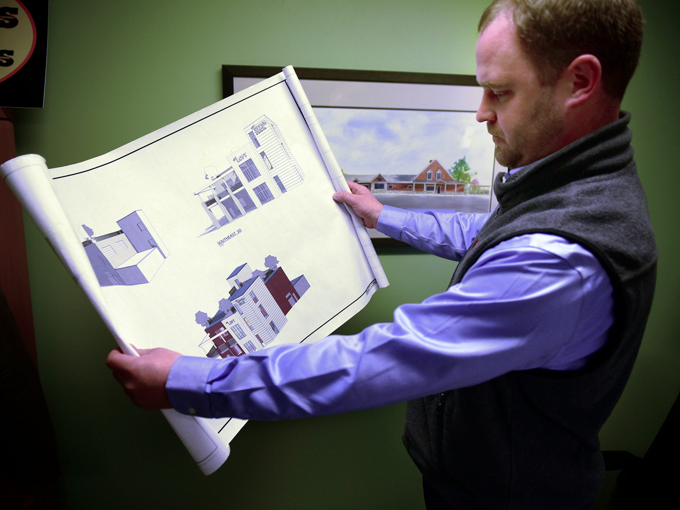 Leo Schoenhofen, president and CEO of The Butcher Shoppe, looks over plans for Grant Street Loft, an event center the Schoenhofen's hope to open by the early fall. Located in the old Jennings dealership building at North Second and Grant streets, it will also have a commercial kitchen that will help ease the growing load at The Butcher Shoppe.