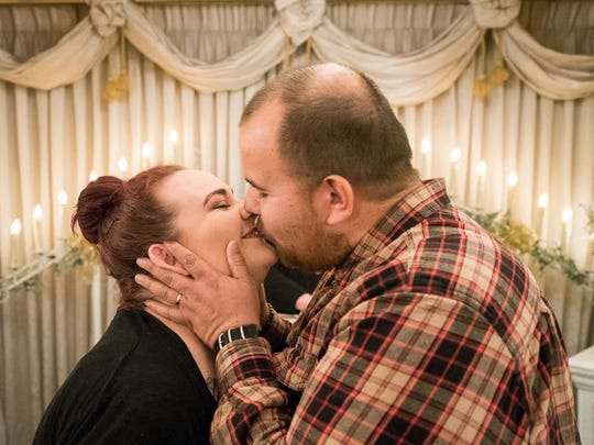 Brittanie, 23, and Kennith Camp, 33, got married on the last day Chapel of the Bells on W. Fourth Street was open. It closed at the end of Feb. 28, 2018 after almost 56 years of providing quick drive-through and drive-up weddings for Reno locals and tourists.