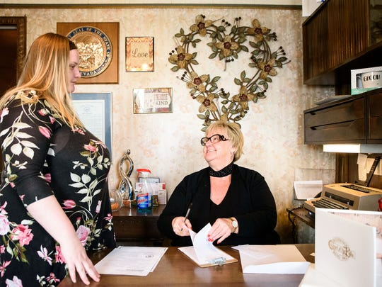 Ellen Pfister, 21, and mother Margaret Flint, run the Chapel of the Bells on W. Fourth Street. The wedding chapel closed Feb. 28, 2018 after almost 56 years of providing quick drive-through and drive-up weddings for Reno locals and tourists.
