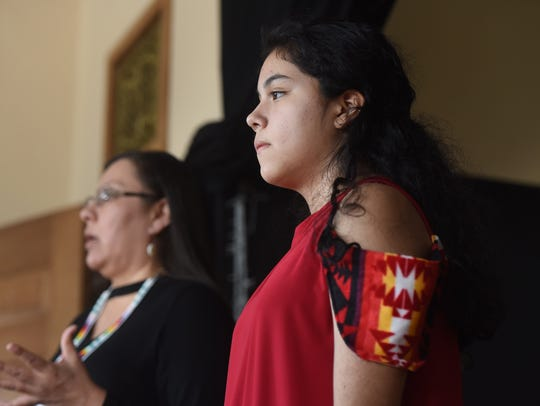 Blackfeet designer Belinda Bullshoe, left, speaks to volunteer models as Keeley RunningCrane looks on at the High Noon Indigenous Fashion Show March 15 at the Paris Gibson Square Museum of Art. The goal of the show was to draw attention to the thousands of missing indigenous women across Montana, the U.S. and Canada.