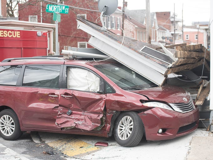A minivan and UPS truck collided at the intersection
