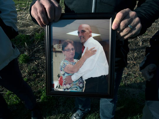 John Barton holds a picture of his late brother Clinton Shaffer and his mother Shirley Shaffer.