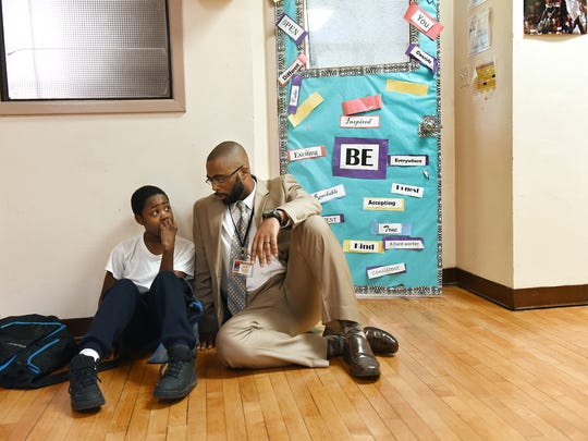 Paterson Leadership Academy for Young Men Principal Jasonn L. Denard (CQ) visits with fifth-grader Jermere Abrams (CQ) 10. The academy has 54 students in third, fourth and fifth grade, with one class in each grade. Abrams said he was having a bit of a rough day.    Monday, November 23, 2015 --