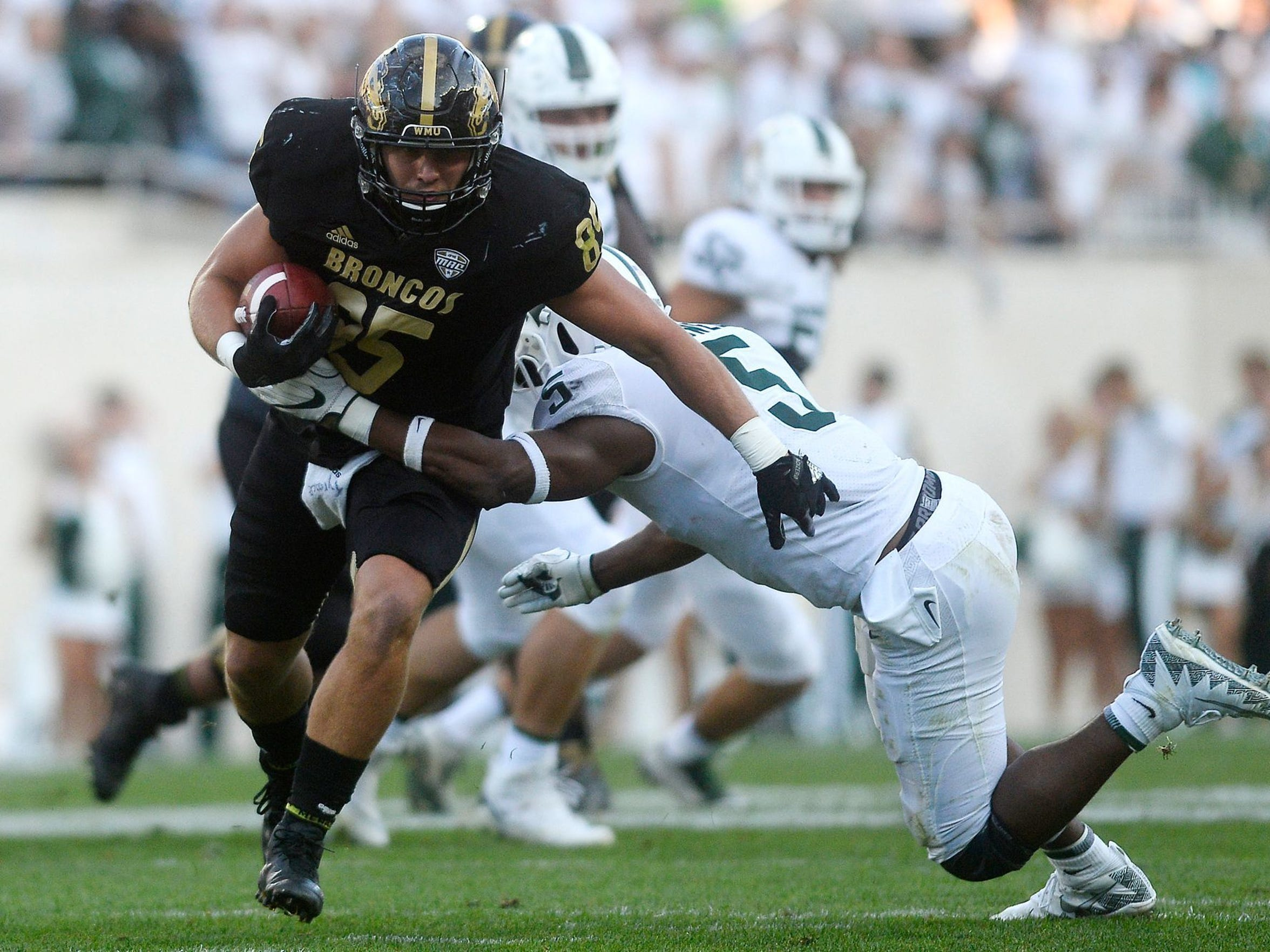 Western Michigan tight end Donnie Ernsberger (85) catches a pass as Michigan State's Andrew Dowell closes in during the fourth quarter on Saturday, Sept. 9, 2017, at Spartan Stadium in East Lansing.
