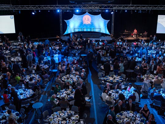 Guests mingle during the fourth-annual Lansing Promise