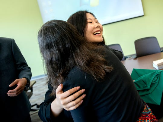 Michigan State University student Xiaoyi Sun, right, hugs Broad College of Business Associate Dean for Undergraduate Programs Cathy Petroni during a lunch for Chinese students graduating from the Broad College of Business on Saturday, May 5, 2018, at Brody Hall on the MSU campus in East Lansing.