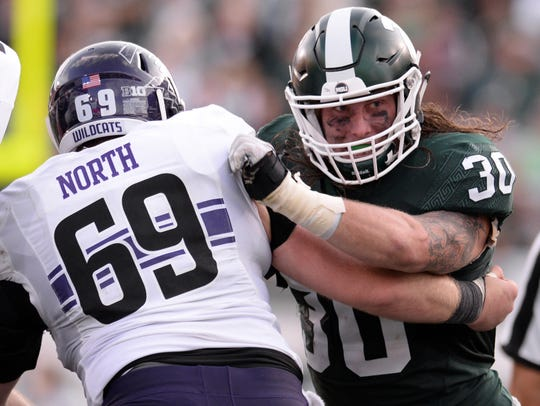 Senior linebacker Riley Bullough sheds the block of