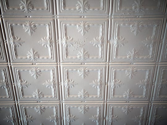 The painted tin ceiling inside the Strange School photographed